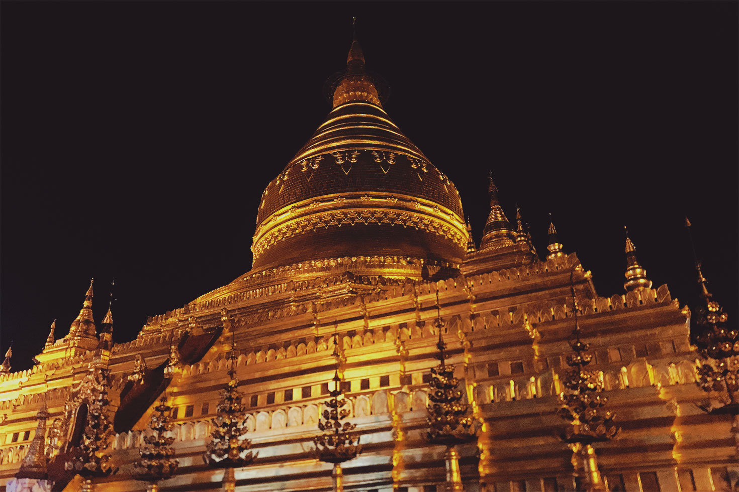 Shwezigon Pagoda by night in Bagan, Myanmar, where the upper floor is closed