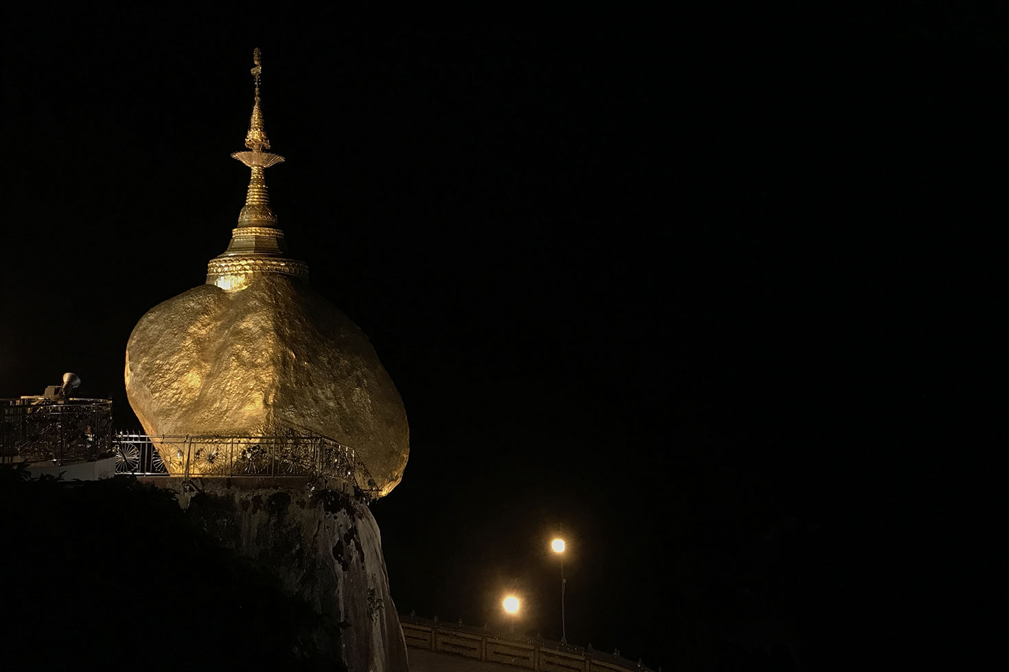 The golden rock of Mount Kyaiktiyo by night